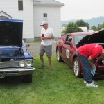 Jerry making last minutes touch ups.  Ed deciding his car is clean enough!